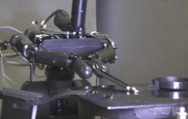 Ishikawa Komuro Lab's high-speed robot hand grasping a grain of rice with tweezers
