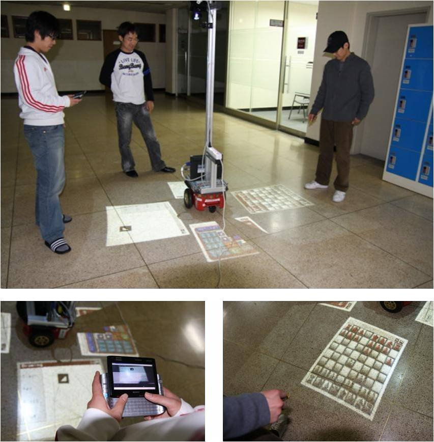 Robots With Video Projectors And Laser Pointer Interfaces