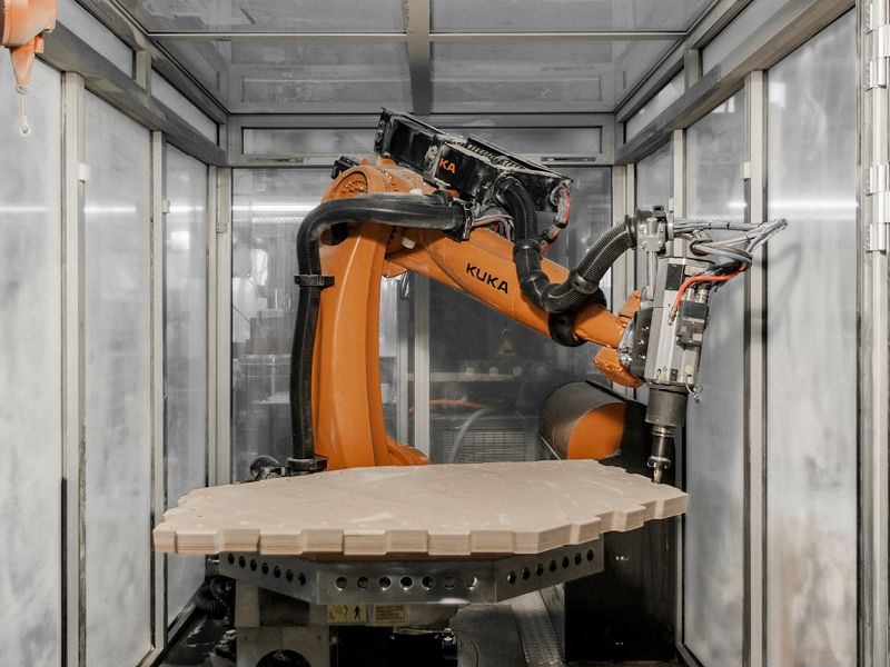 Robot building a panelized house